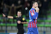 Caen's French midfielder Julien Feret celebrates after scoring a penalty kick during the French L1 football match between Caen and Toulouse on...