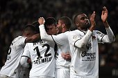 Caen's French midfielder Julien Feret celebrates with his teammates after scoring during the French L1 football match Rennes against Caen at the...