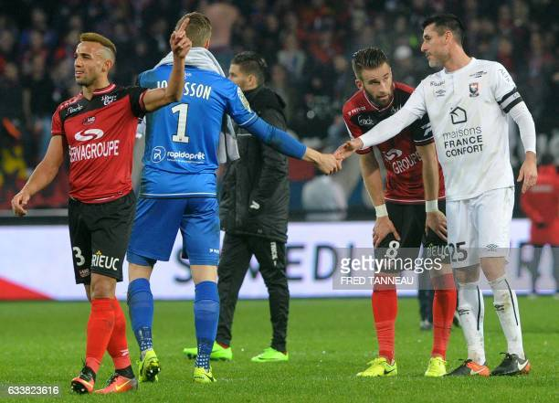 Caen's French midfielder Julien Feret congratulates Guingamp's Danish goalkeeper KarlJohan Johnsson at the end of the French L1 football match...