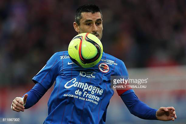 Caen's French midfielder Julien Feret controls the ball during the French L1 football match between Caen and Rennes on February 21 2016 at the Michel...