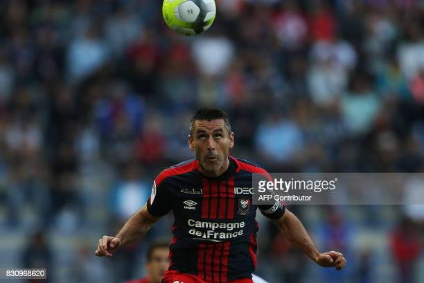 Caen's French midfielder Julien Feret heads the ball during the French L1 football match between Caen and SaintEtienne on August 12 at the Michel...