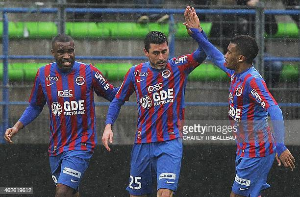 Caen's French midfielder Julien Feret is congratulated by teammates after scoring a goal during the French L1 football match between Caen and...