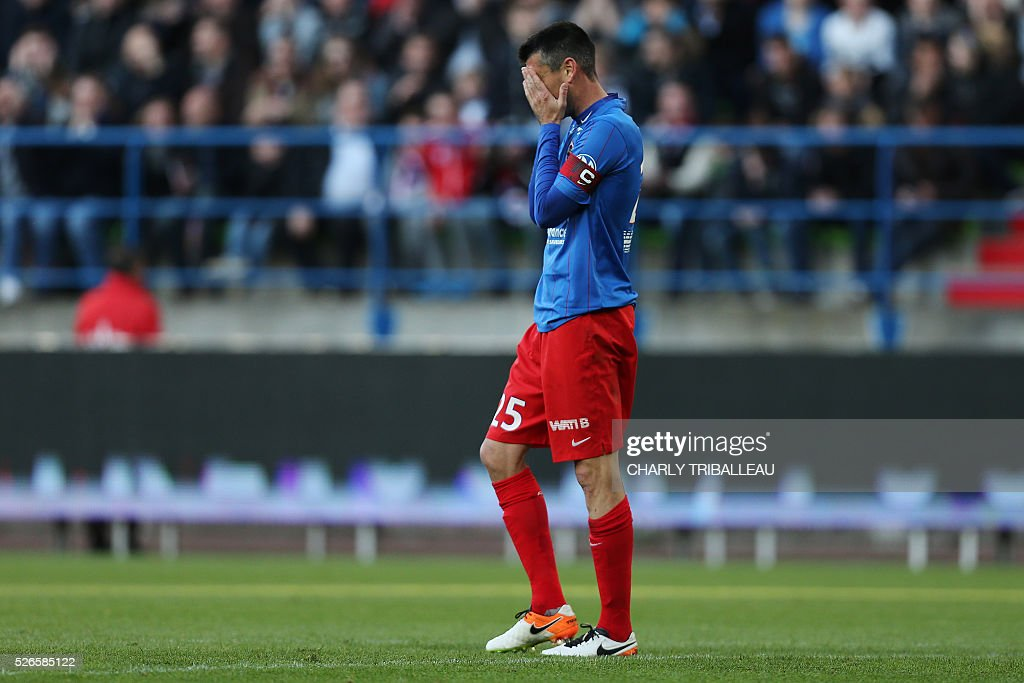 Caen's French midfielder Julien Feret reacts during the French L1 football match between Caen (SM Caen) and Bastia (SC Bastia), on April 30, 2016 at the Michel d'Ornano stadium, in Caen, northwestern France.
