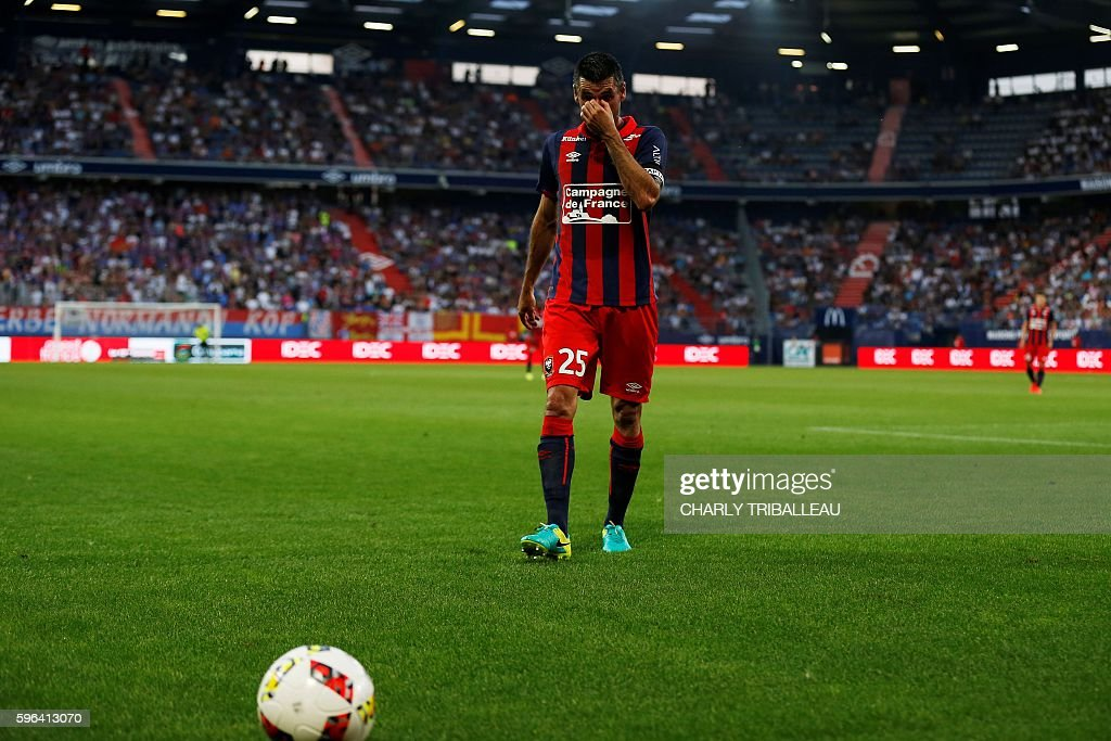 Caen's French midfielder Julien Feret reacts during the French L1 football match between Caen and Bastia on August 27 2016 at the Michel d'Ornano...