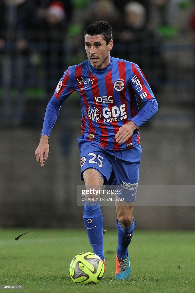 Caen's French midfielder Julien Feret runs with the ball during the French L1 football match between Caen and Bastia on December 20 at the Michel...