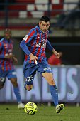 Caen's French midfielder Julien Feret runs with the ball during the French L1 football match between Caen and Lens on February 21 2015 at the Michel...