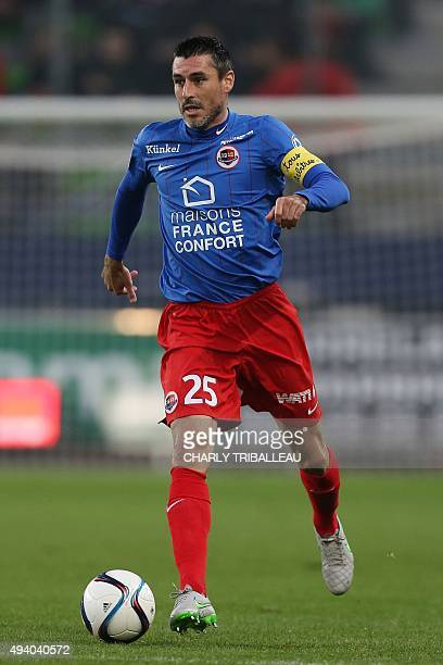 Caen's French midfielder Julien Feret runs with the ball during the French L1 football match between Caen and Nantes on October 23 at the Michel...