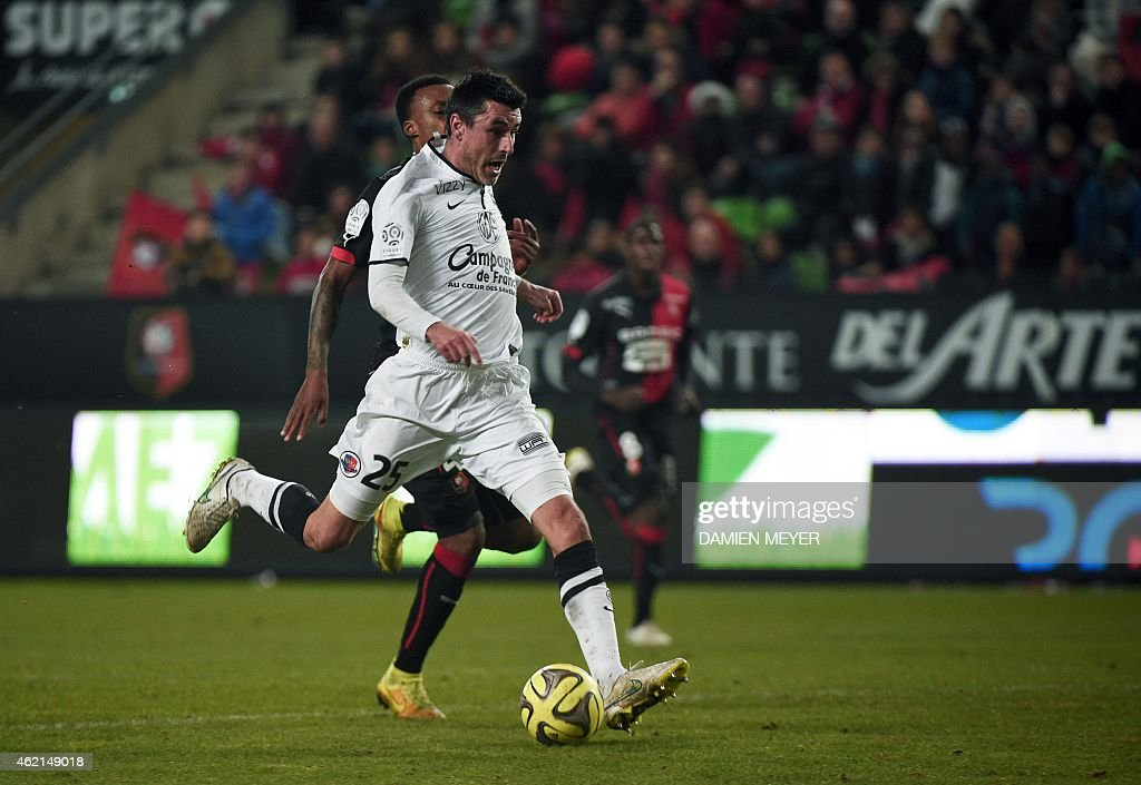 Caen's French midfielder Julien Feret scores during the French L1 football match Rennes against Caen at the route de Lorient stadium in Rennes...