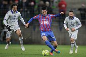 Caen's French midfielder Julien Feret vies for the ball with Bastia's French defender FrançoisJoseph Modesto during the French L1 football match Caen...