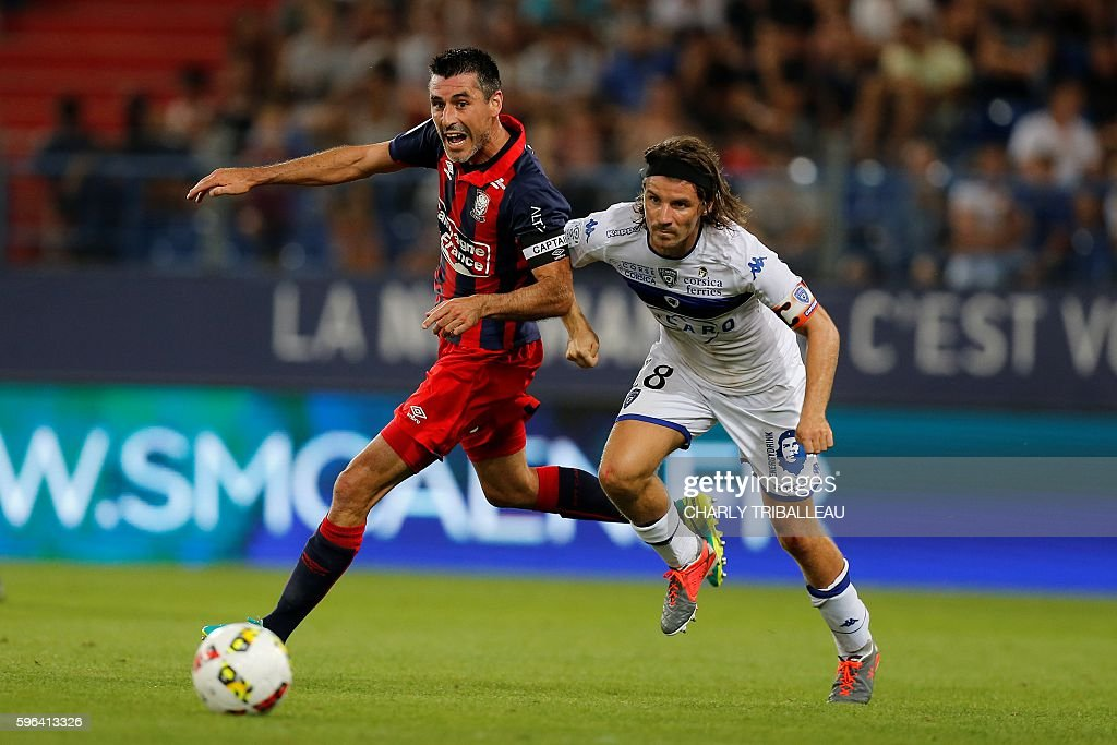 Caen's French midfielder Julien Feret vies for the ball with Bastia's French midfielder Yannick Cahuzac during the French L1 football match between...