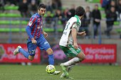 Caen's French midfielder Julien Feret vies for the ball with SaintEtienne's French defender Paul Baysse during the French L1 football match between...