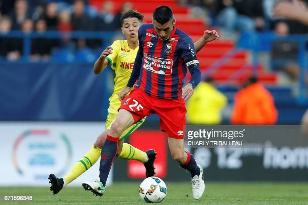 Caen's French midfielder Julien Feret vies with Nantes' French midfielder Amine Harit during the French L1 football match between Caen and Nantes on...