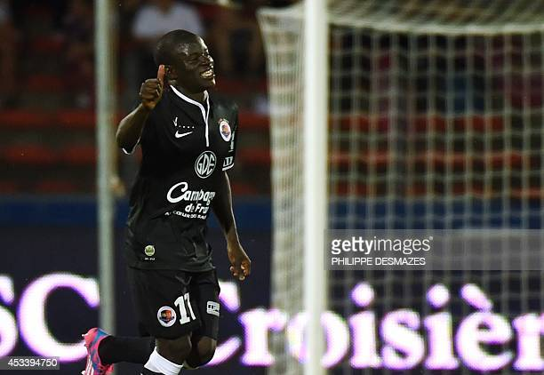 Caen's French midfielder N'golo Kante reacts after scoring during the French L1 football match EvianThonon Gaillard FC against SM Caen on August 9...