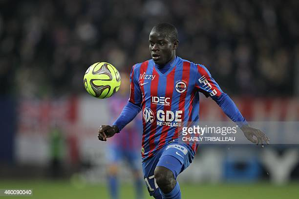 Caen's French midfielder N'golo Kante runs with the ball during the French L1 football match between Caen and Nice on December 6 at the Michel...
