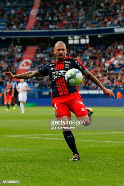 Caen's French midfielder Vincent Bessat kicks the ball during the French L1 football match between Caen and SaintEtienne on August 12 at the Michel...