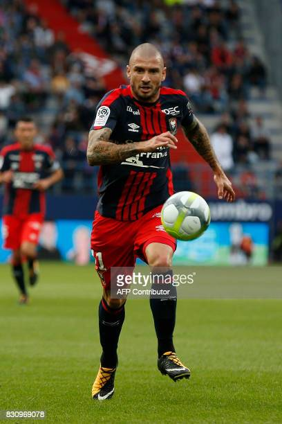 Caen's French midfielder Vincent Bessat runs with the ball during the French L1 football match between Caen and SaintEtienne on August 12 at the...