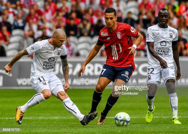 Caen's French midfielder Vincent Bessat vies with Lille's DutchMorrocan forward Anwar ElGhazi during the French L1 football match Lille vs Caen on...