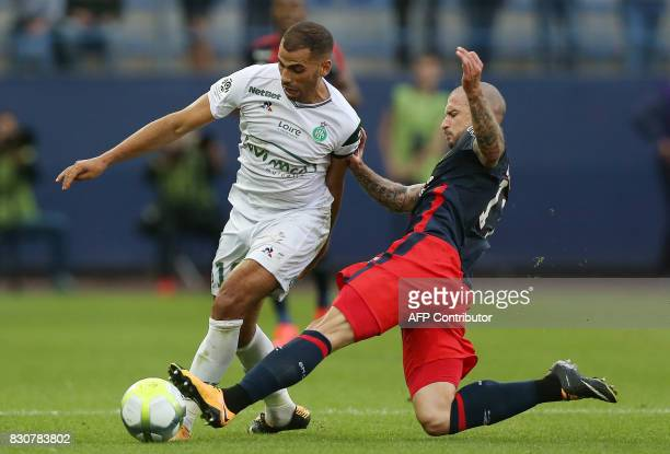 Caen's French midfielder Vincent Bessat vies with SaintEtienne's French forward Oussama Tannane during the French L1 football match between Caen and...
