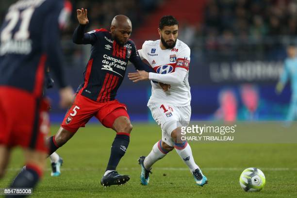 Caen's FrenchGuinean midfielder Baissama Sankoh vies with Lyon's French midfielder Nabil Fekir during the French L1 football match between Caen and...