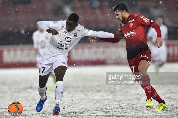 Caen's FrenchIvorian forward Yann Karamoh vies with Dijon's Algerian midfielder Mehdi Abeid during the French L1 football match between Dijon and...