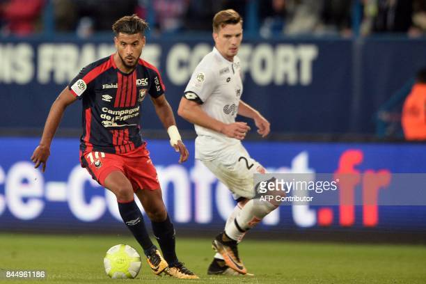 Caen's FrenchMoroccan midfielder Youssef Ait Bennasser vies with Dijon's French forward Benjamin Jeannot during the French L1 football match between...