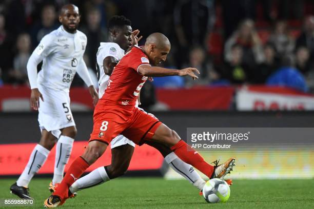 Caen's Haitian defender Romain Genevois vies with Rennes' Tunisian midfielder Wahbi Khazri during the French L1 football match between Stade Rennais...