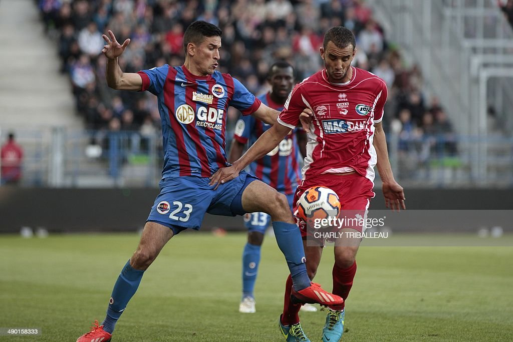 Caen's Jean Calve vies with Nimes' Samir Benmeziane during the French L2 football match Caen vs Nimes at the Michel d'Ornano stadium in Caen on May...
