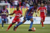 Caen's Jonathan Kodjia vies with Nimes' Mouri ola Ogunbiyi during the French L2 football match Caen vs Nimes at the Michel d'Ornano stadium in Caen...