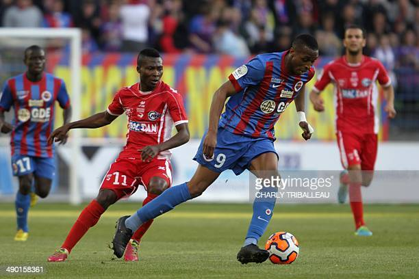 Caen's Jonathan Kodjia vies with Nimes' Mouri ola Ogunbiyi during the French L2 football match Caen vs Nimes at the Michel d'Ornano stadium in Caen...