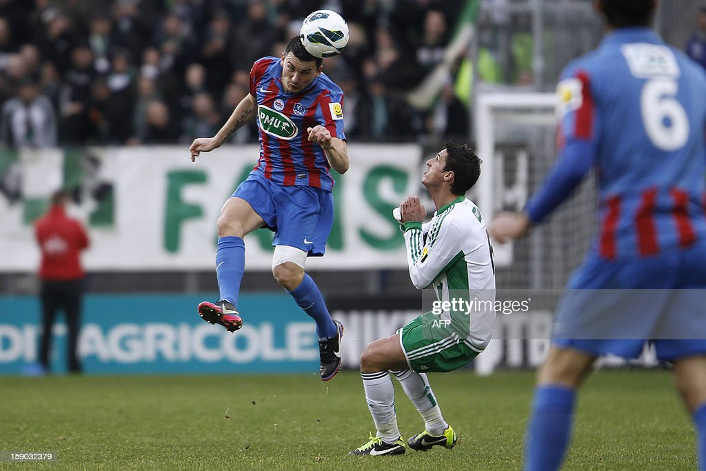 Caen's Mathieu Duhamel (L) heads the ball next to Saint Etienne's Jeremy Clement (R) during the French cup football match Caen vs Saint-Etienne at the Michel-d'Ornano stadium, on January 6, 2013 in Caen. AFP PHOTO/CHARLY TRIBALLEAU.