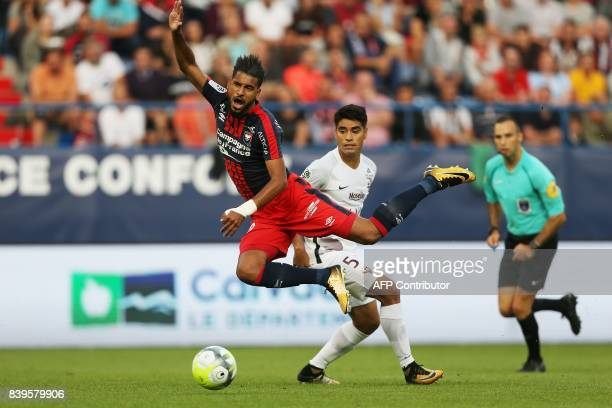 Caen's Moroccan midfielder Youssef Ait Bennasser jumps over the ball during the French L1 football match between Caen and Metz on August 26 at the...