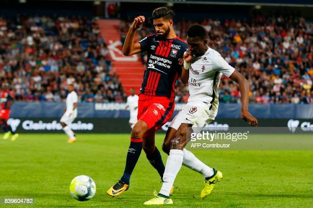 Caen's Moroccan midfielder Youssef Ait Bennasser vies for the ball with Metz's French forward Opa Nguette during the French L1 football match between...