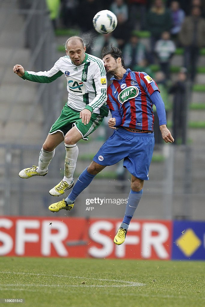 Caen's Nicolas Seube (R) vies with Saint Etienne's Renaud Cohade (L) during a French Cup football match between Caen and Saint Etienne at the Michel d'Ornano stadium, on January 6, 2013 in Caen.