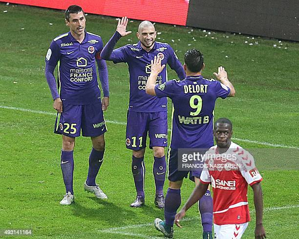 Caen's players celebrate after Caen's French midfielder Julien Feret scored a goal during the French Ligue 1 football match between Reims and Caen on...