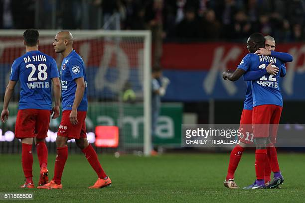 Caen's players celebrate at the end of the French L1 football match between Caen and Rennes on February 21 2016 at the Michel d'Ornano stadium in...
