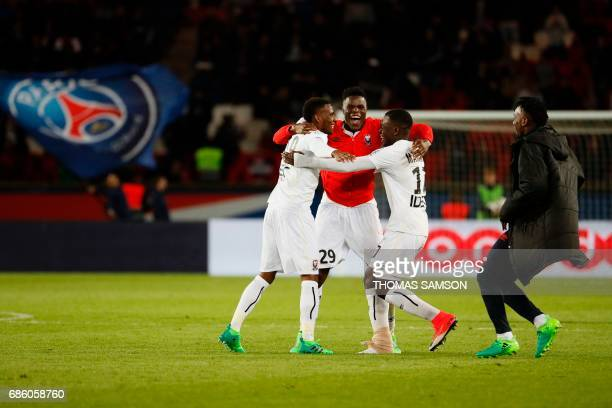 Caen's players react at the end of the French L1 football match between Paris SaintGermain and Caen on May 20 at the Parc des Princes stadium in...