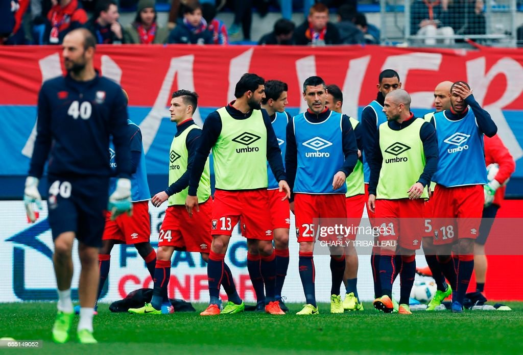 Caen's players warm up before the French L1 football match between Caen (SMC) and Monaco (AS), on March 19, 2017 at the Michel d'Ornano stadium, in Caen, northwestern France. /