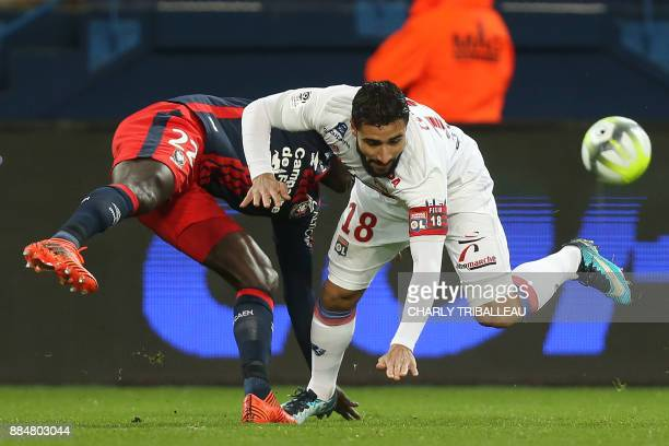 Caen's Senegalese defender Adama Mbengue vies for the ball with Lyon's French midfielder Nabil Fekir during the French L1 football match between Caen...