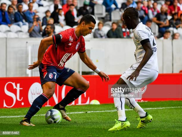 Caen's Senegalese defender Adama Mbengue vies with Lille's DutchMorrocan forward Anwar ElGhazi during the French L1 football match Lille vs Caen on...