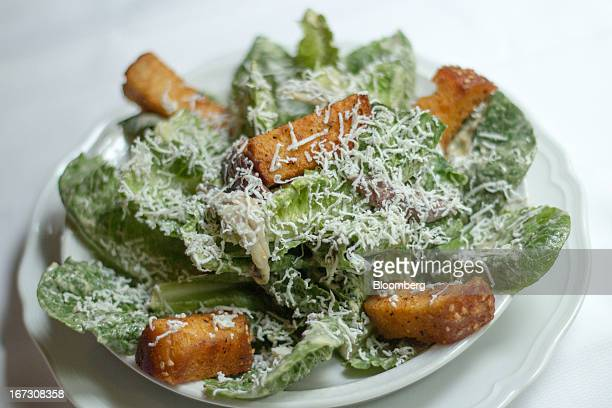 Caesar salad is served at Carbone restaurant in New York US on Tuesday April 23 2013 The ingredients include parmesanslicked lettuce anchovy fillets...