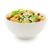 Caesar salad with bacon, capers, parmesan and croutons isolated on white (excluding the shadow)