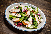 Caesar salad on wooden background