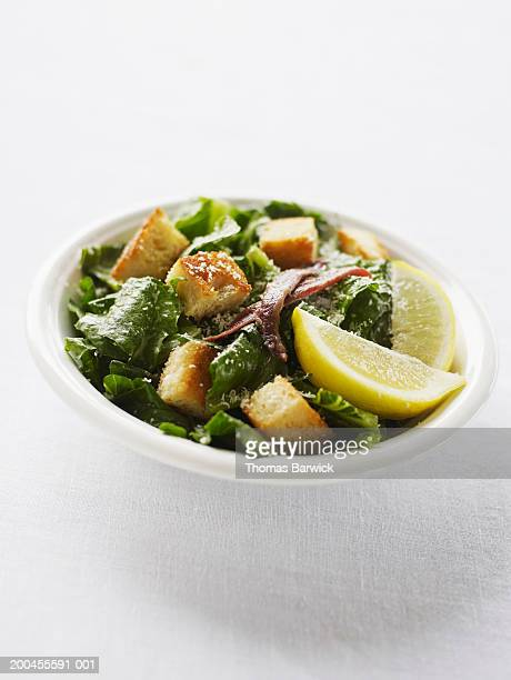 Caesar salad with parmesan, croutons, anchovies and lemon wedges