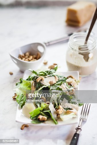Caesar Salad with roasted cashews on plate