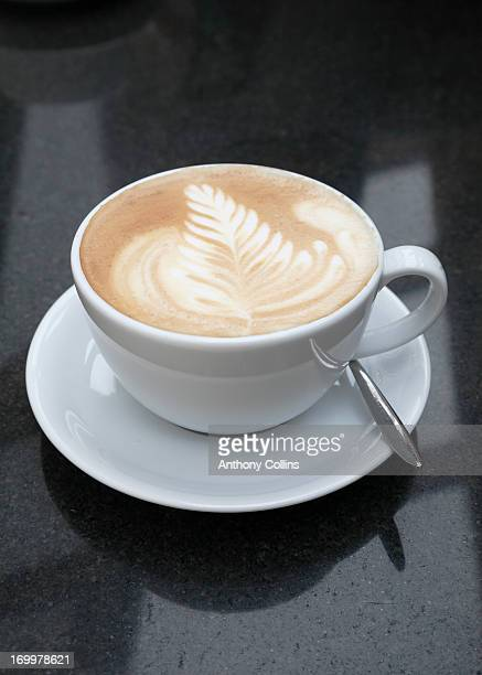 Cafe latte or flat white coffee on a granite table