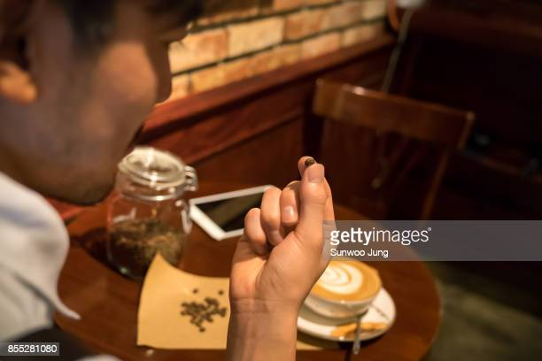 Cafe owner checking products in store