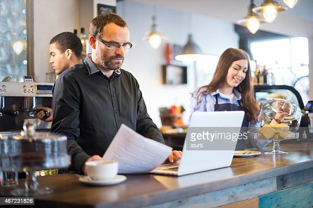 cafe owner doing his paperwork