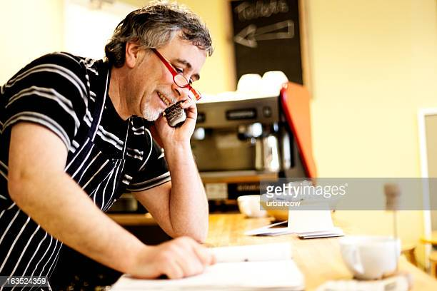 Cafe owner on the phone