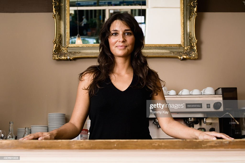Cafe Owner Standing Behind Counter