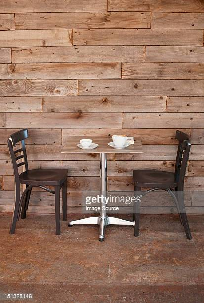 Cafe table with two empty chairs